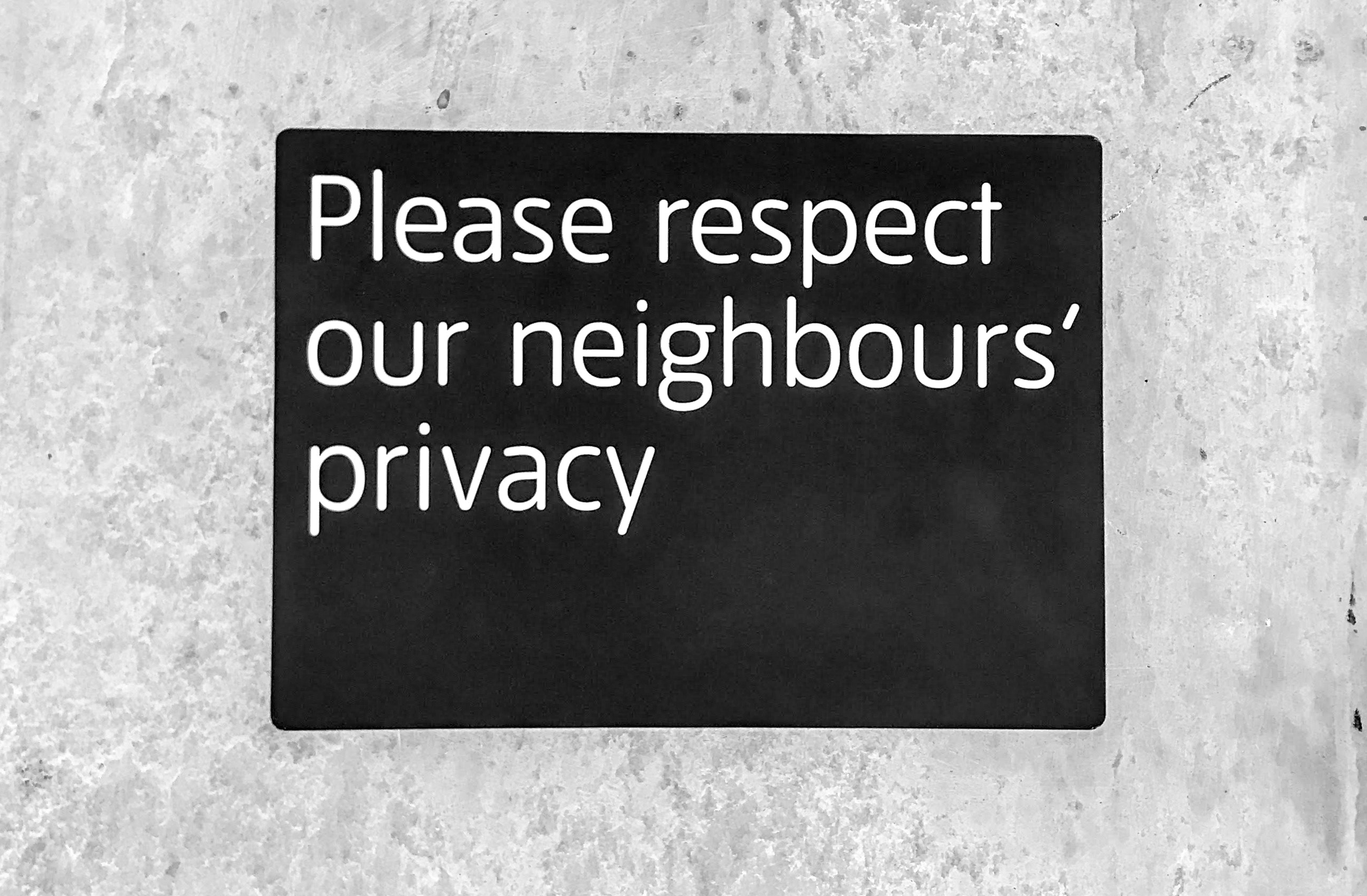 sign saying please respect our neighbour's privacy